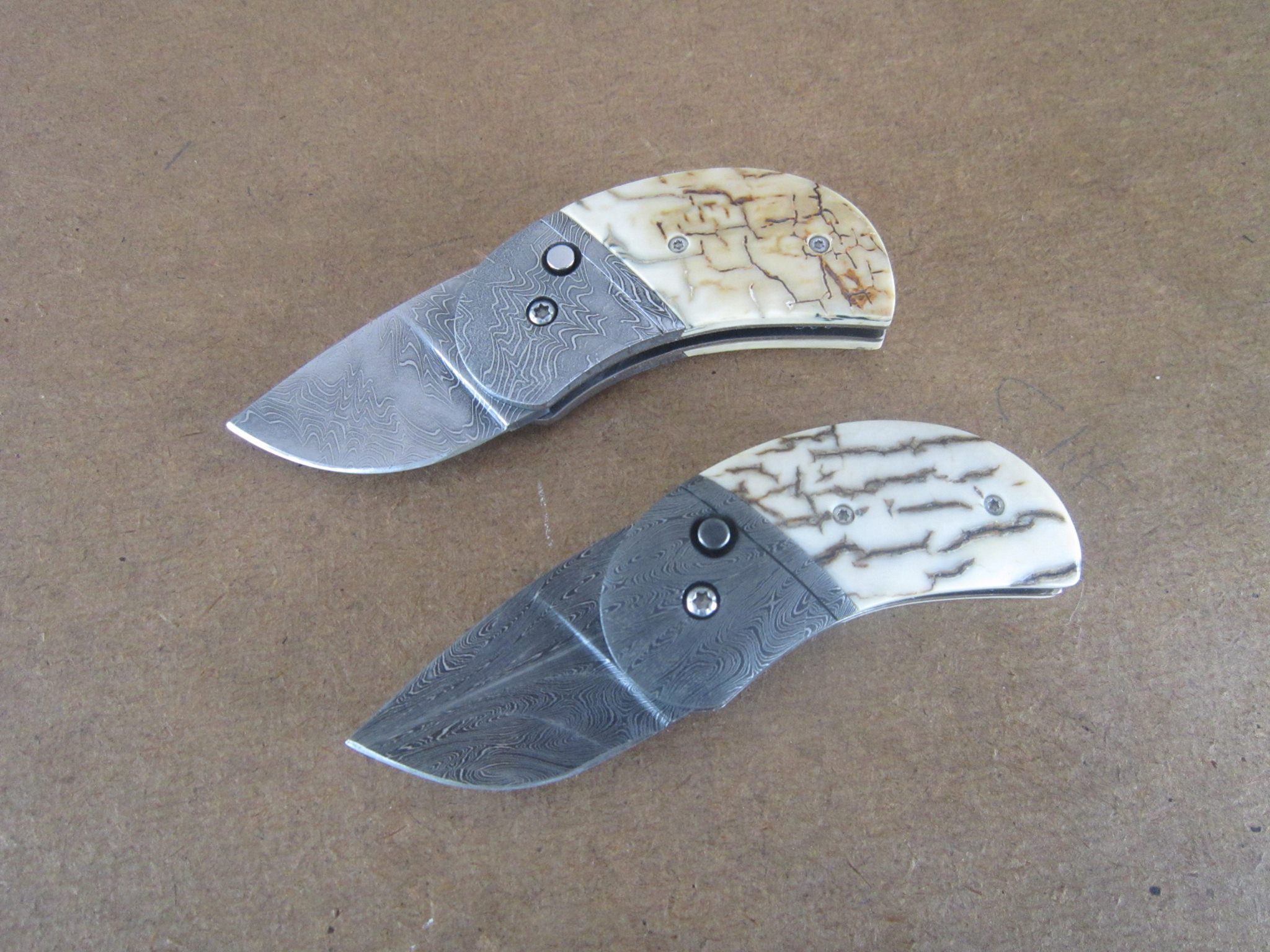 phil booth folder HHH damascus